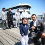 groom and son before pictures on a skyline princess wedding cruise